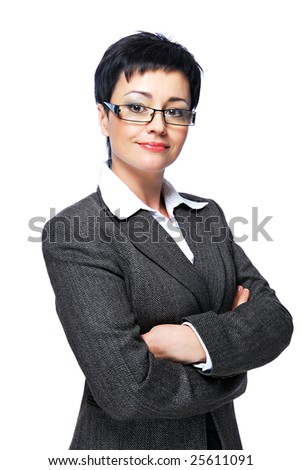 Mid adult businesswoman in grey business suit with crossed-arms - stock photo