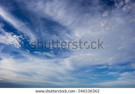 Middle level altocumus and altostratus  with high cirrus cloud formations  on a sunny afternoon in early summer   are contrasted against the blue Australian sky in tropical Broome, Western Australia.