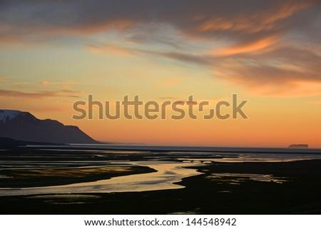 Midnight sunset  near saudarkrokur, Iceland  - stock photo