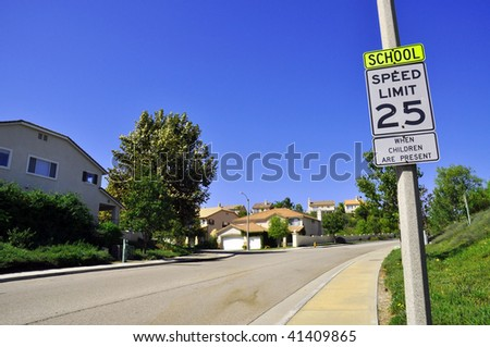 25 mile an hour sign post, street - stock photo