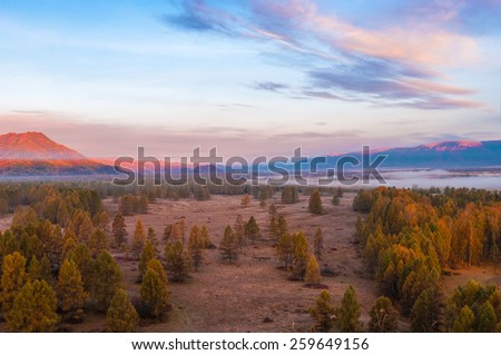 Mist at dawn in the mountains - stock photo