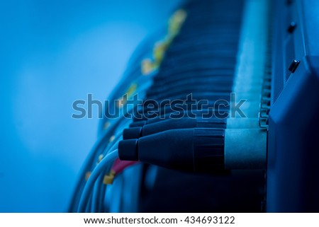 mixer,xlr,input ,interconnect,Audio jack cable connected at rear end of mixer at broadcasting,shallow depth of field. - stock photo