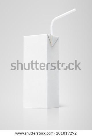 200 ml milk or juice white carton package with straw on gray background - stock photo