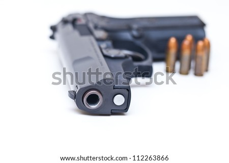 9 mm Black handgun isolated on a white background. - stock photo