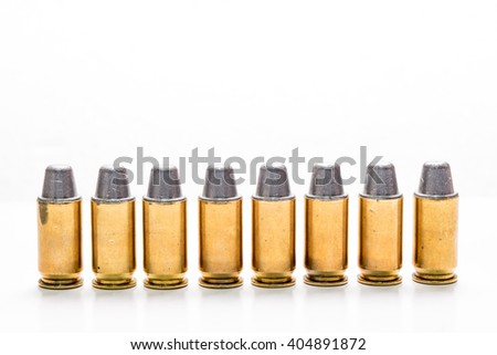 .45mm bullet for a gun isolated on white background. - stock photo
