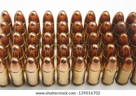 9mm bullets in a row - stock photo