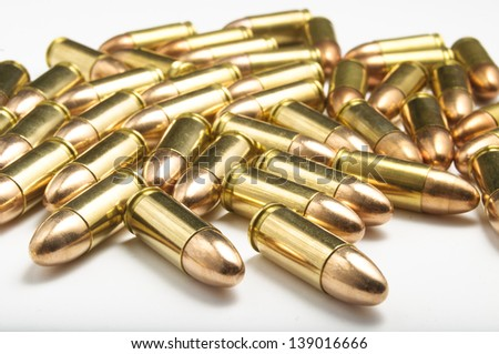 9mm bullets on white background - stock photo