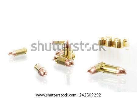 9 mm. bullets on white background - stock photo