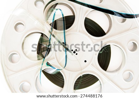 35 mm cinema movie reel with film detail  on white background - stock photo