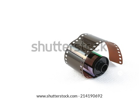 35 mm film in cartridge on a white background. - stock photo