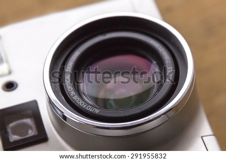 35 mm film reflex camera with negatives, slides and film - stock photo
