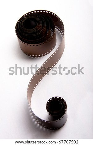 35mm film rolls on white background - stock photo