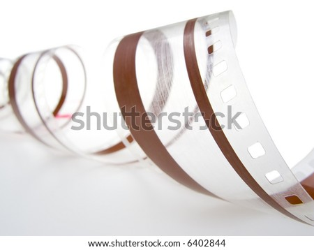 35 mm film with audio magnetic track isolated in white background. Shallow depth of field. - stock photo
