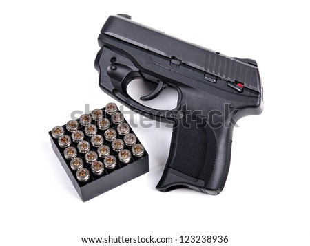 9mm Handgun and a box of Ammo - stock photo