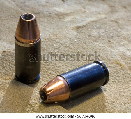 9 mm hollow point self defense rounds in copper - stock photo