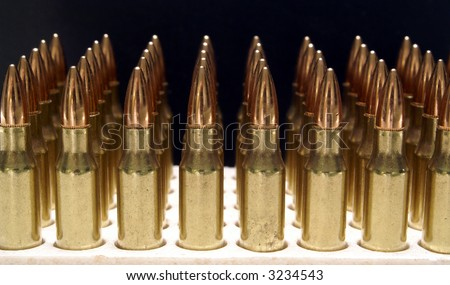 5.56mm .223 M16 AR15 rifle bullets vertical fading into background - stock photo