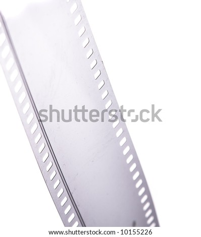 35 mm motion picture film with dust particles on, isolated on white - stock photo