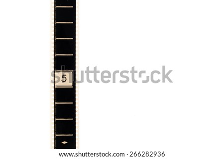 35mm movie film with number five frame countdown, vertical and copyspace isolated on white background - stock photo