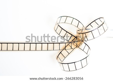 35mm movie filmstrip, film bow on white background, empty frames copyspace - stock photo