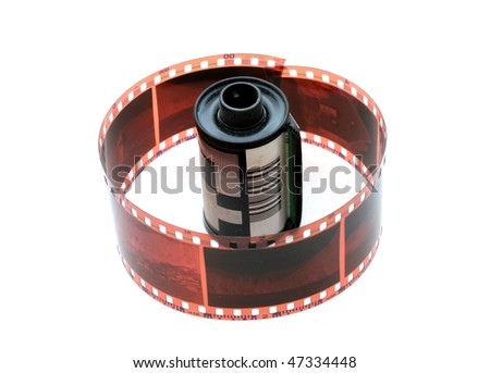 35 mm negative film and roll isolated in white background - stock photo