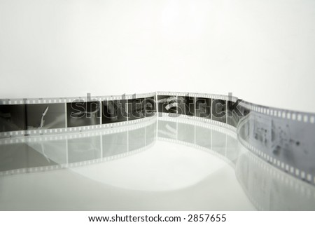 35 mm negative film strips (with saxophone photos) - stock photo