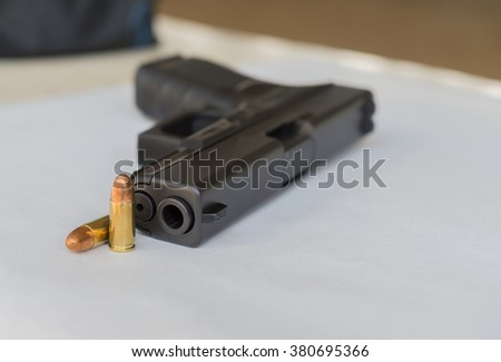 9 mm pistol and cartridges with copy space