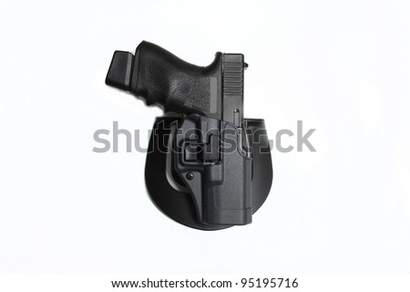 9mm pistol in a holster - stock photo