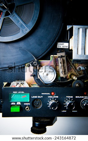 8mm projector body part with film reel, knobs and spools, vintage color look - stock photo
