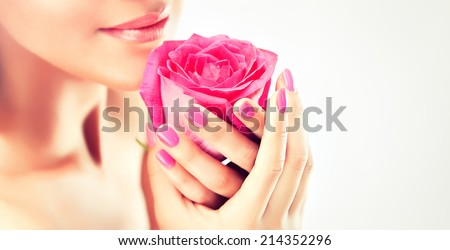 model keeps a gentle flower , manicure and Spa - stock photo