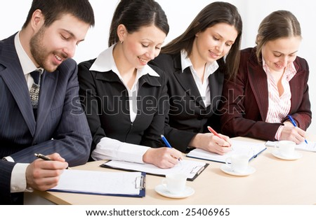 Modern businesspeople at a seminar - stock photo