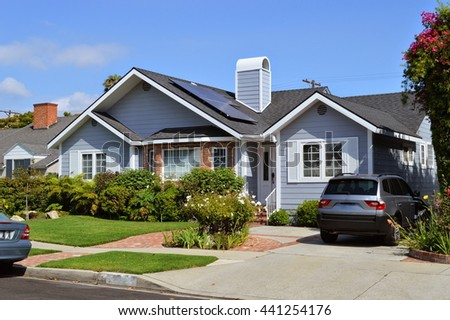 Modern house with garden, chimney and solar panels on the gable roof. LA, CA . - stock photo