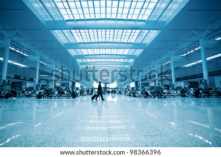 modern train station waiting room and passengers motion blur in shanghai