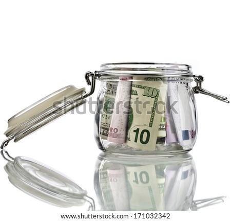 Money jar full of savings  isolated on white background - stock photo