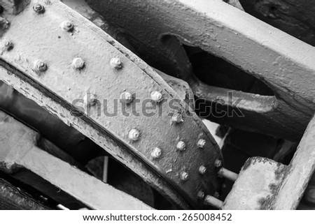 Monochrome abstract old industrial mechanism details assembly, selective focus and shallow DOF - stock photo