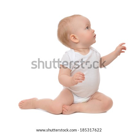 10 month child baby toddler sitting happy pointing finger hand at the corner isolated on a white background - stock photo