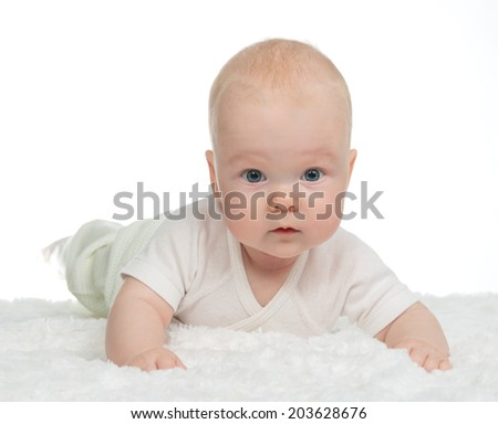 4 month infant child girl toddler lying on a soft blanket on a white background