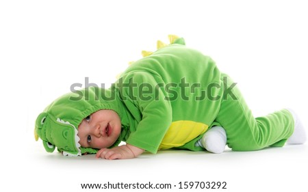 18-month-old baby boy in green dragon costume for Halloween - stock photo