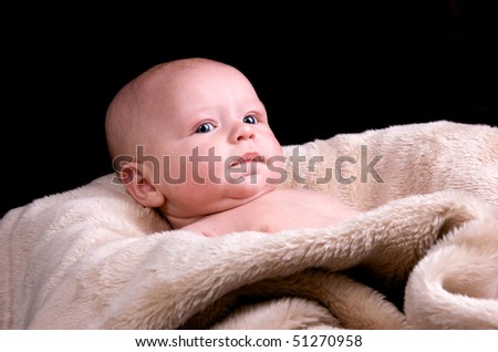 3 month old baby looking away from camera - stock photo