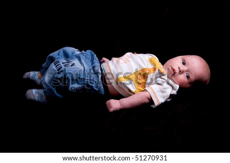 3 month old baby on a black background - stock photo