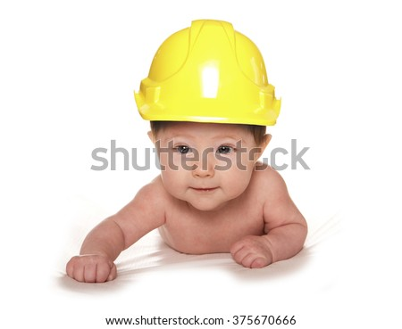 3 Month old baby wearing builders hard hat cutout - stock photo