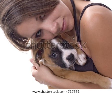 3 month old Boxer puppy with 'mom' - stock photo