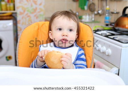 16 months baby eating bread