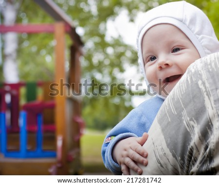 4 months old baby boy in the playground  - stock photo