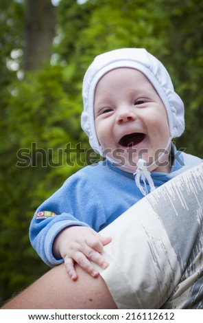 4 months old baby boy laughing - stock photo
