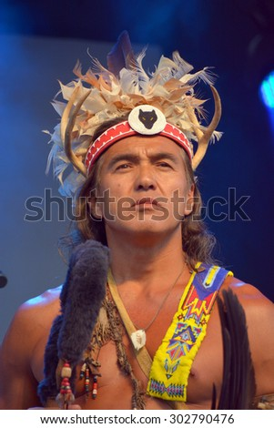 MONTREAL QUEBEC CANADA AUGUST 01 2015: Native Indian front  Mohawk people in traditional costume are the most easterly tribe of the Iroquois Confederacy. - stock photo