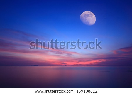 Moonlight over blue sea and fire sky ,Long exposure technique  - stock photo
