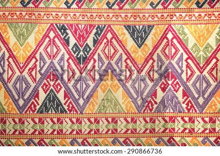 More than 200 years old colorful thai handcraft peruvian style rug surface old vintage torn conservation Made from natural materials Chemical free close up.  - stock photo