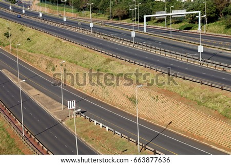 Morning landscape close up of empty M41 freeway with on and off ramps passing through Mhlanga ridge  in Durban, South Africa