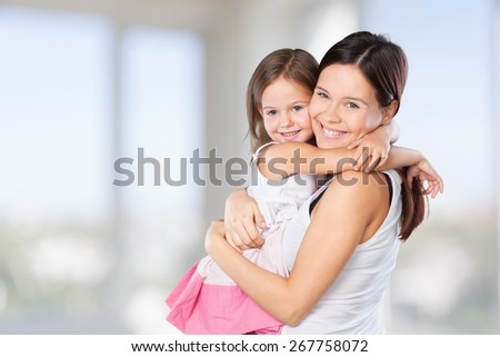 8. Mother and daughter look at each other - portrait on isolated  white background  Happy family people concept. - stock photo
