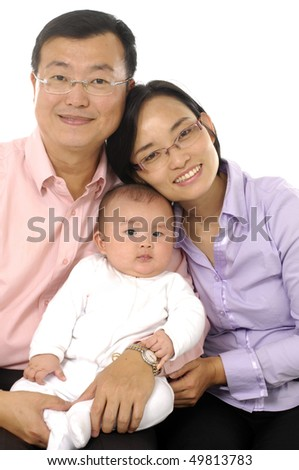 mother and father with young son on white - stock photo